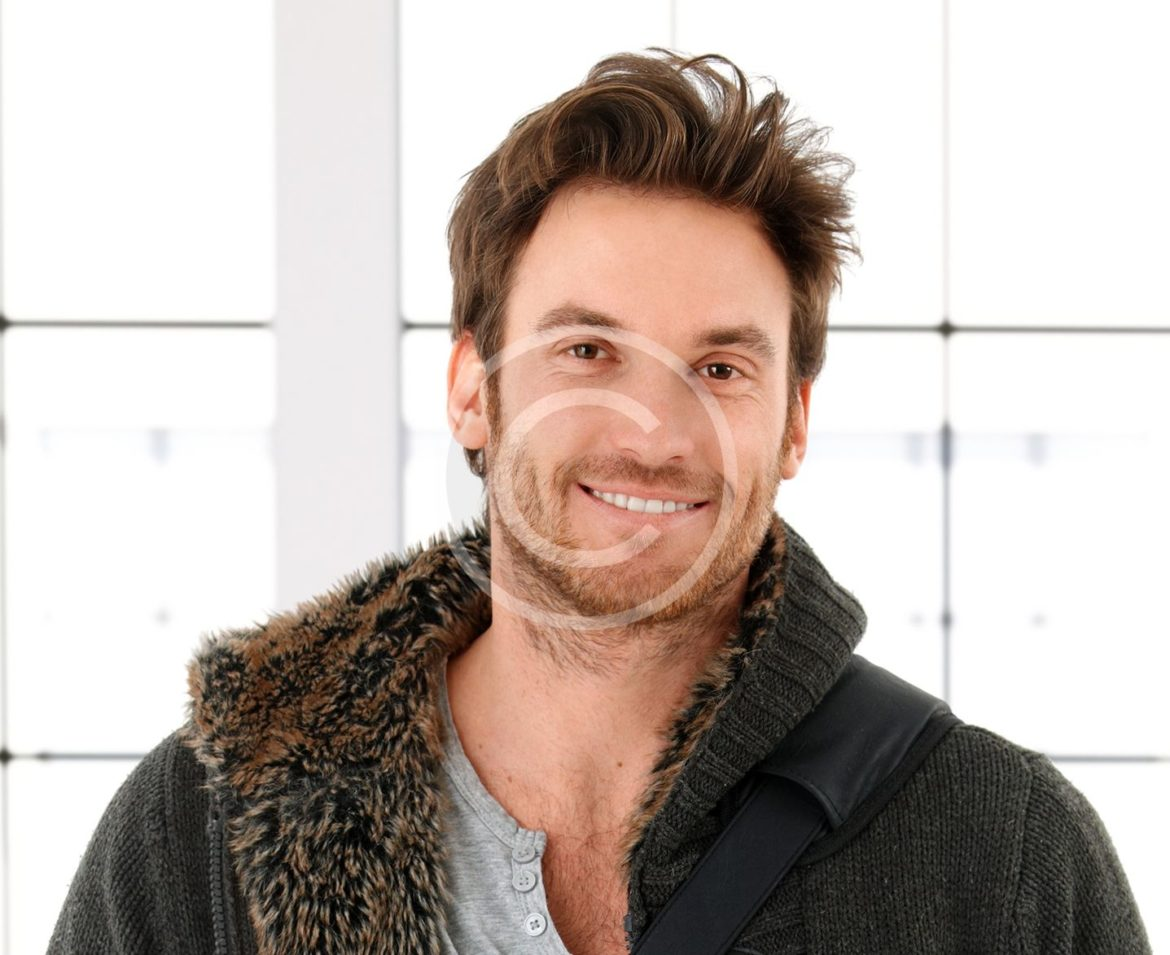 bigstock-Trendy-young-man-at-home-smil-52362661.jpg